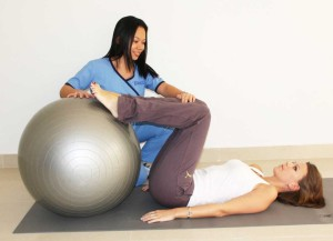 Pilates instructor with ball